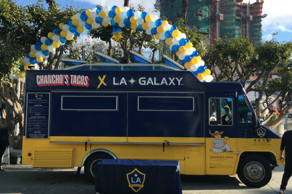 Our Partners From The La Galaxy Prepping To Give Out Tacos