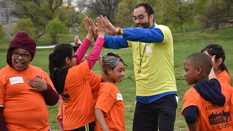 LeagueApps' Lead Designer Javie Rios Loves Giving Out High-Fives (Photo Credit: Volo City Kids)